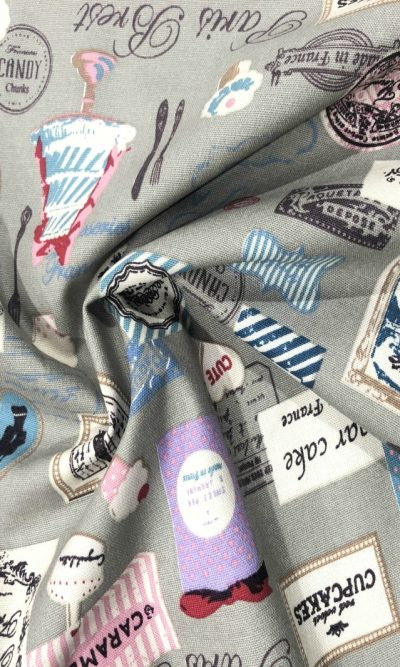 patisserie-francaise-print-canvas-fabric-on-taupe-grey-fabric